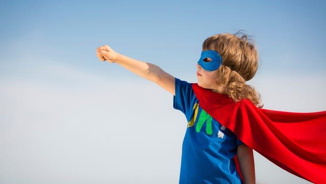 Kid dresses up as a super hero.