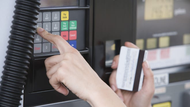 A consumer pays at the gas pump with a credit card.