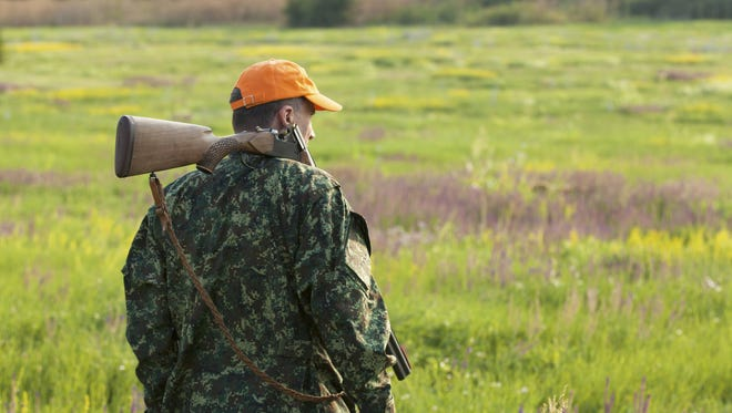 Male hunter looking at field.