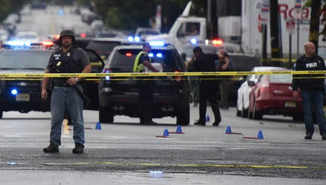 Police secure the scene at East Elizabeth Avenue and Roselle Street in Linden, N.J., after two officers were wounded Sept. 19, 2016, in a shootout with Manhattan bombing suspect Ahmad Khan Rahami.