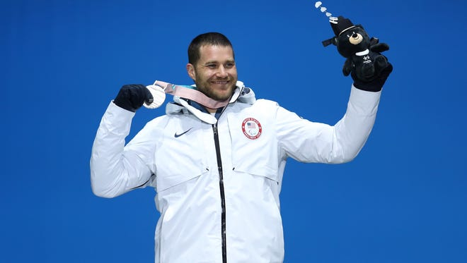 Silver medallist Mike Schultz of USA celebrates during the medal ceremony for the Men's Snowboard Banked Slalom SB-LL1 Final on day seven of the PyeongChang 2018 Paralympic Games on March 16, 2018 in Pyeongchang-gun, South Korea.  (Photo by Linnea Rheborg/Getty Images)