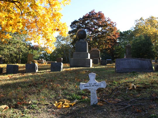 The sun lights the gravestones at Rose Hill Cemetery.