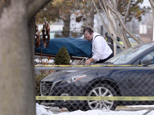 One of four bodies is removed from the home of the