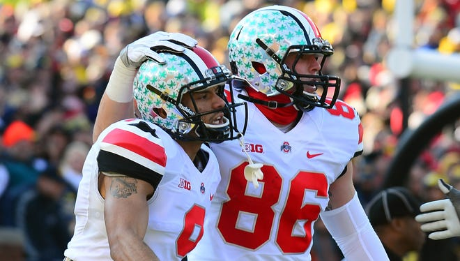 Ohio State wide receiver Devin Smith (9) celebrates with teammate Jeff Heuerman (86) after catching a pass for a touchdown during the first quarter Saturday against Michigan.