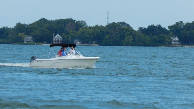 A boat makes its way around the Lake Erie Islands.