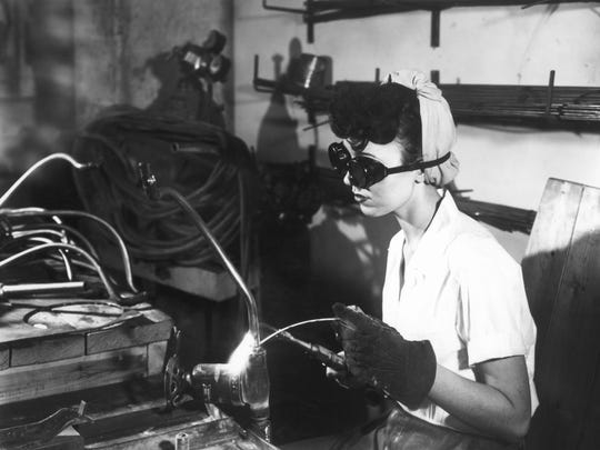 A worker in the K-25 plant during World War II. (ED WESTCOTT/DEPARTMENT OF ENERGY)