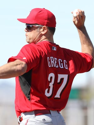 Kevin Gregg throws during drills.