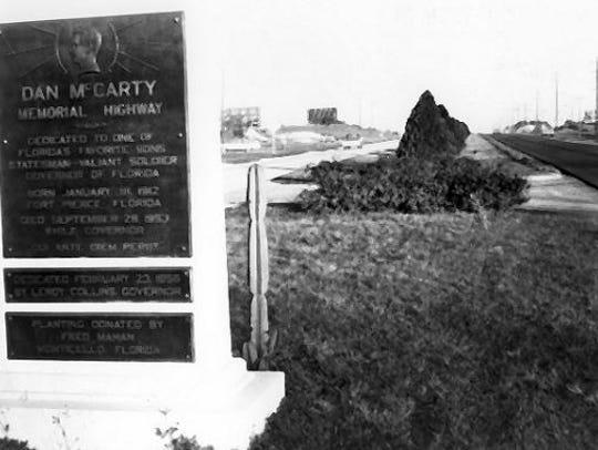 The Dan McCarty Memorial Highway marker sits across