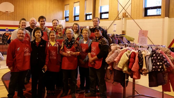 Salvation Army volunteers stood ready to distribute coats during a recent annual event.