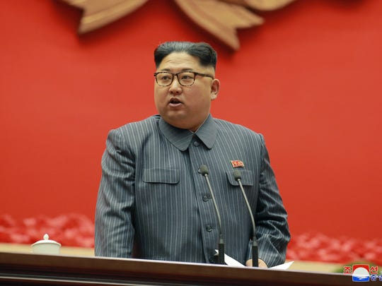In this Dec. 23, 2017, file photo distributed on Dec. 24, 2017, by the North Korean government, North Korean leader Kim Jong Un speaks during the conference of cell chairpersons of the ruling party in Pyongyang.  Kim said the United States should be aware that his country's nuclear forces are now a reality, not a threat.
