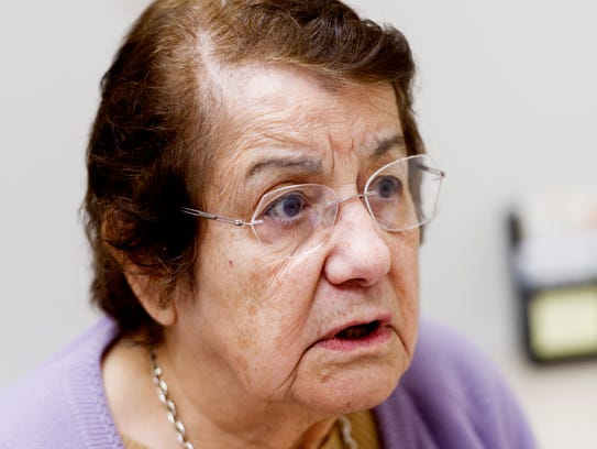 Blanca Simonian speaks with a patient in Spanish at
