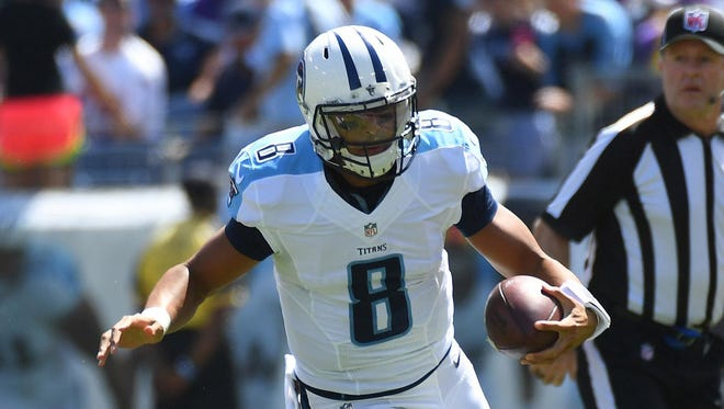 Tennessee Titans quarterback Marcus Mariota runs for a first down last week against the Minnesota Vikings.