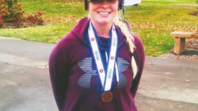 Eldon's Kassidy Hull with her fourth place medal at the Class 2 State Tournament in New Bloomfield.