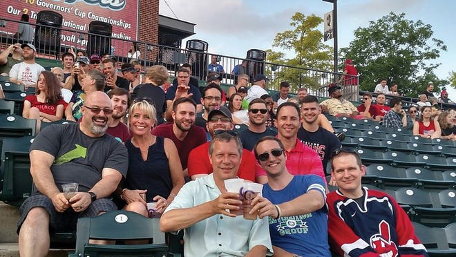 The Revolution Group team with CEO Rick Snide, front left, and Marketing Director Cindy Snide, second row, second seat.