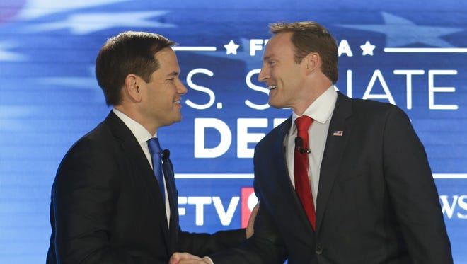 Sen. Marco Rubio, R-Fla., left, and Rep. Patrick Murphy, D-Fla., shake hands before their debate at the University of Central Florida in Orlando.