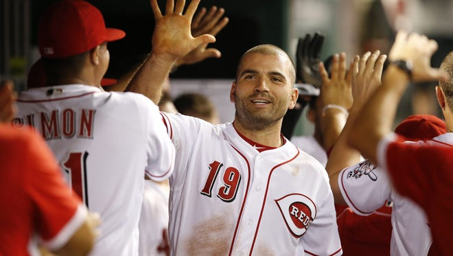 Cincinnati Reds first baseman Joey Votto (19) smiles in the dugout after scoring the go-ahead run in the seventh inning during the MLB National League game between the Miami Marlins and the Cincinnati Reds, Wednesday, Aug. 17, 2016, at Great American Ball Park in Cincinnati.