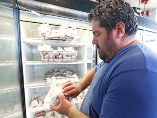 Seth Hoerman, Hörrmann Meats co-owner, stocks a freezer on Thursday, Aug. 25, 2016.