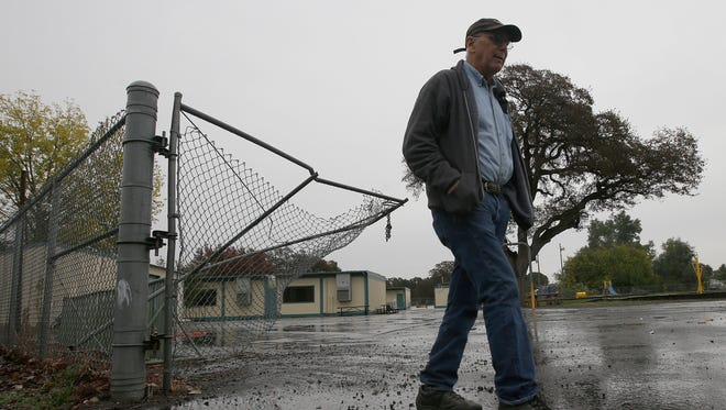 Randy Morehouse, the maintenance and operations supervisor for the Corning Elementary School District, walks past the gate, at the Rancho Tehama Elementary School, on Nov. 15, 2017, that gunman Kevin Janson Neal crashed through during his shooting rampage at Rancho Tehama Reserve.