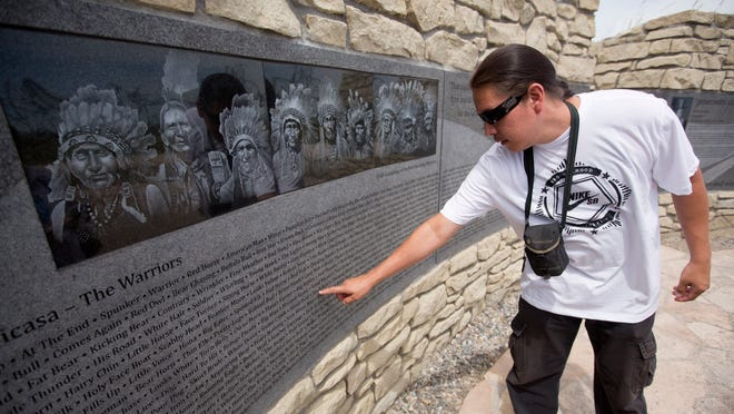 In this photo taken on Wednesday, Sicangue Lakotah member Eric LaPointe finds his grandfather Black Bear's name on the Zuya Wicasa panel on the Indian Memorial at the Little Bighorn National Monument in Garryowen. Six of LaPointe's ancestors are listed on the panel. A ceremony on Wednesday marked the completion of the memorial to Indian warriors, 138 years after their defeat of Lt. Col. George A. Custer and the 7th Cavalry.