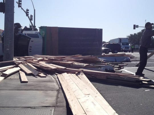 A truck overturned and spilled lumber onto Highway 111 Sunday at Jefferson Street.
