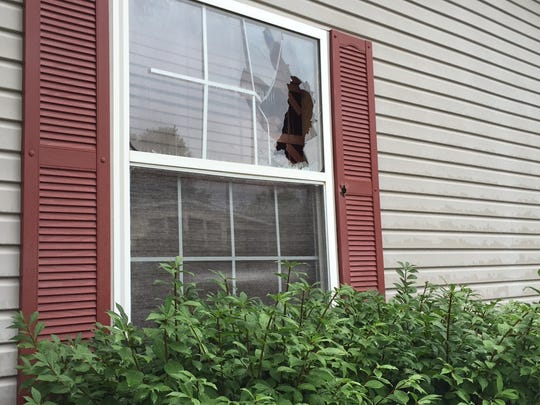 Attempts were made to subdue the 35-year-old man arrested Monday after a 15-hour SWAT standoff. The front windows of the home showed holes in the glass from where the SWAT team shot gas canisters inside.