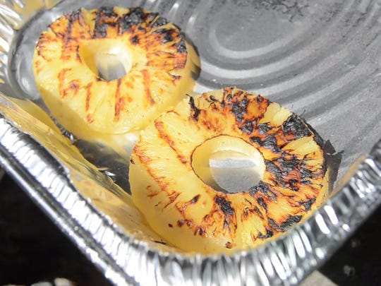 Many fruits can benefit from a quick session on the grill. Even if you're just planning on putting them on a cake, like these pineapple rings, putting them on the grill for a few minutes can help caramelize some of their natural sugars.