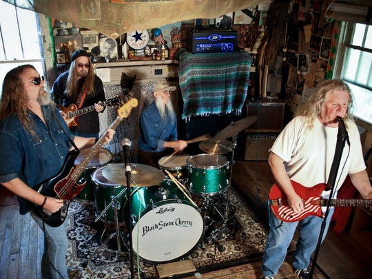 The Kentucky Headhunters jam in the Practice House, where two generations of the Young family have learned to rock.