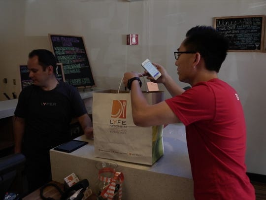 Tony Xu picks up an order for DoorDash from Lyfe Kitchen