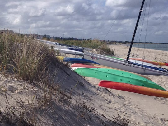 Delaware's proposed beach regulations allow boats on the beach like these in Lewes, but boats that encroach on the dunes will be illegal.
