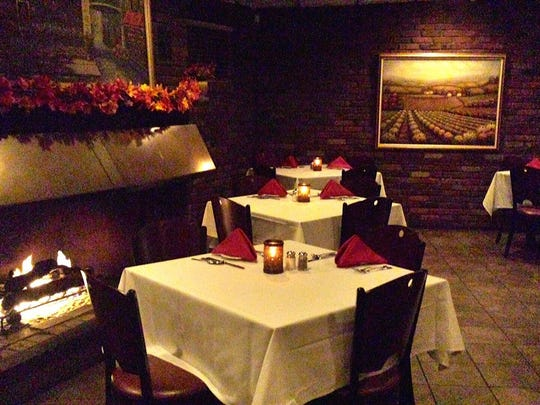 Diners can enjoy a meal by the fire at Tuscany in Brick.