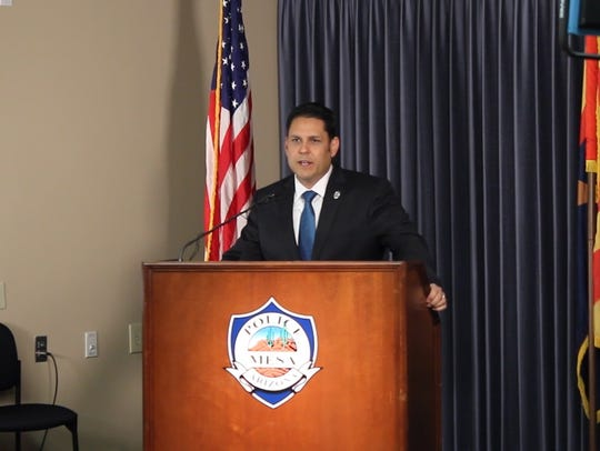Mesa Police Chief John Meza talks to the media about