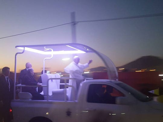 Pope Francis zoomed by Father James B. Hay Catholic School Princpal Julia Fracker and alumni Belen Cardiel in his popemobile after his Mass in Juarez on Wednesday.