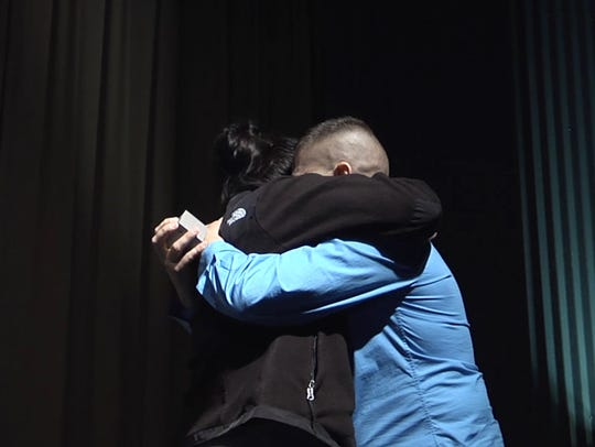 Katie Bird and Louis Simms embrace at the Milton Theatre