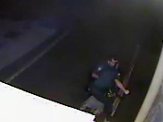 Indio Police Officer Charles Holloway, standing, winds up for a punch during a violent arrest in September 2014.