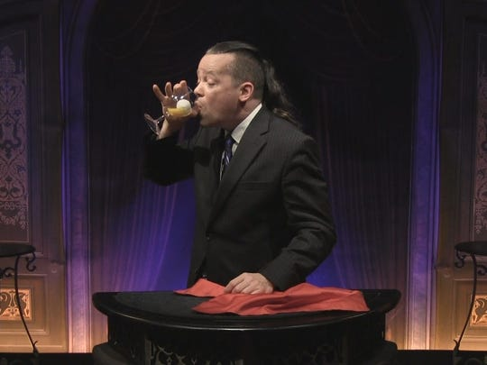 Dan Harlan, magician, performs his drink an egg trick. Harlan is a Fremont native.
