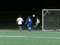 Elizabethtown goalkeeper Austin Denlinger fully extended himself to make a save against Warwick in the Lancaster-Lebanon semifinals Tuesday night. E-Town ultimately won, 4-2.