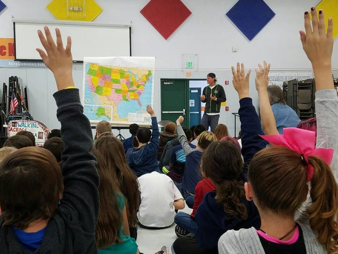 Brett Bramble speaks to students at Sutro Elementary