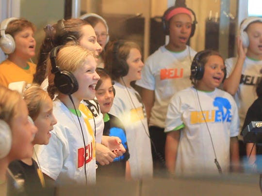 "Children from Wilmington and Greenville traveled to Philadelphia to record the song ""Believe."""