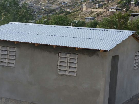 A new latrine with running water is one of the contributions Ezra Vision Ministries has made in its work for the people of Onaville, Haiti.