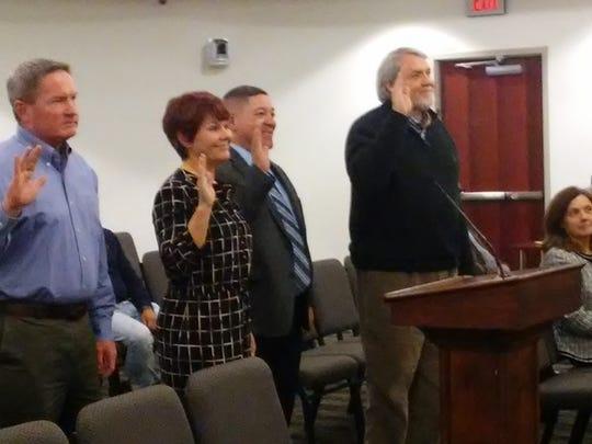 Newly appointed volunteer board members take their