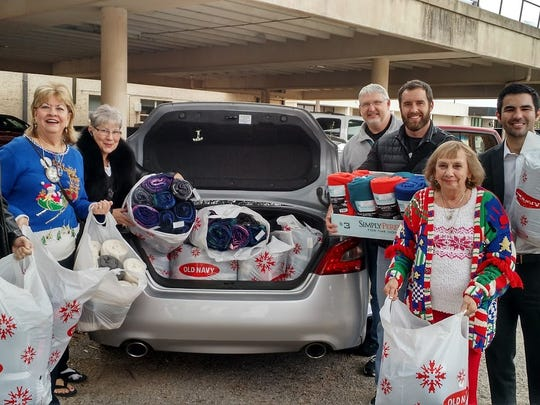 The Kiwanis Club of Greater Abilene presents a donation