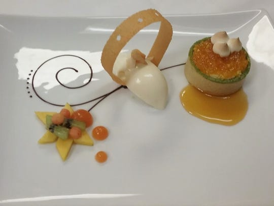 Julian's winning dessert: tropical fruit salad and passion fruit papaya fluid gel (left side of plate), coconut tuile, coconut crème fraiche ice cream (center), and mango tart with toasted passion fruit meringue and mango caramel (right).