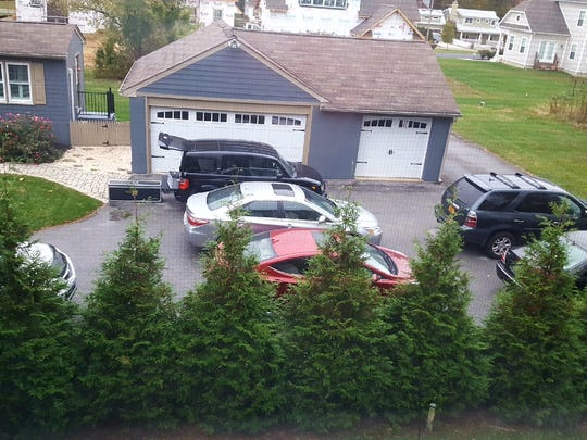The view from Dan Larnick's kitchen window looks out on the parking lot for Bijin Delaware, a home based business in Centerville. Larnick said the photo depicts enough cars to consider a nuisance under county law. County officials have said such traffic could be attributable to the business owner's residential use of the property.