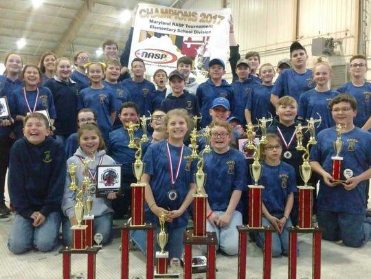 The Holly Grove Archery team won four of the six team