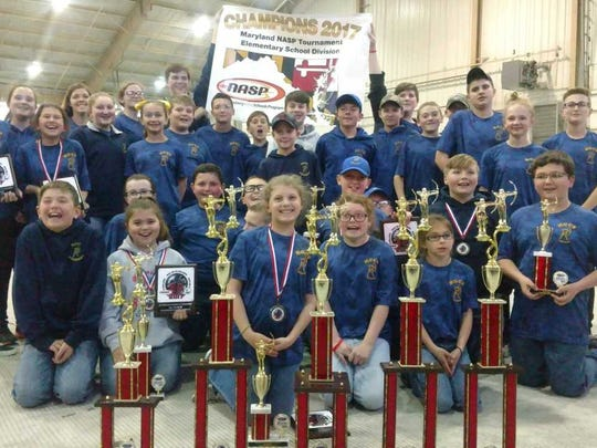 The Holly Grove Archery team won four of the six team