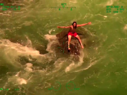 Video still: Tuiolo waits for rescue in the Yuba River