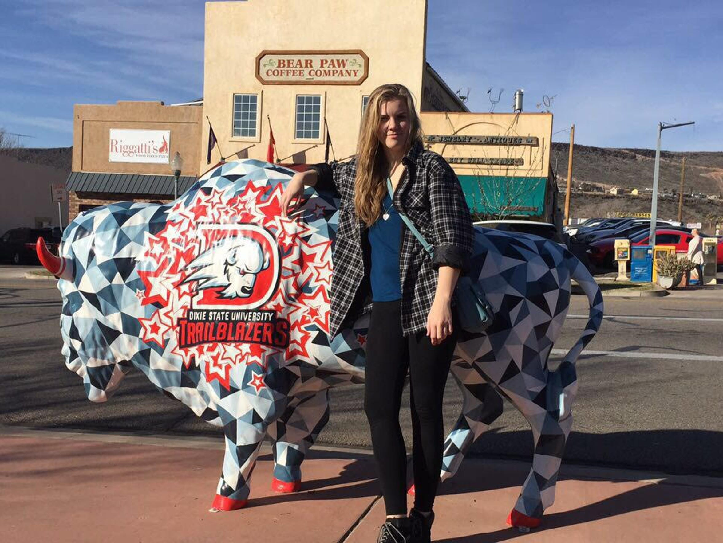 Alannah Hall stands in front of one of Dixie State