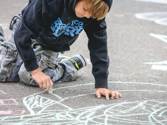 Chalk art is part of the Millstream Arts Festival in