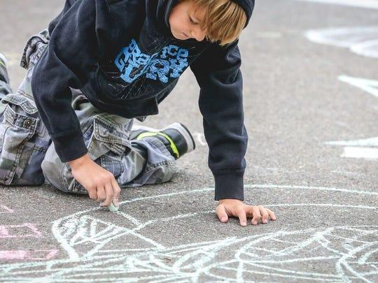 Chalk art is part of the Millstream Arts Festival in St. Joseph.