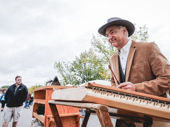 Paul Imholte performs at Millstream Arts Festival in